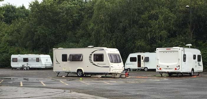 Travellers set up camp on office car park at Fearnhead