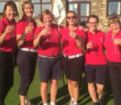 Women golfers celebrating success